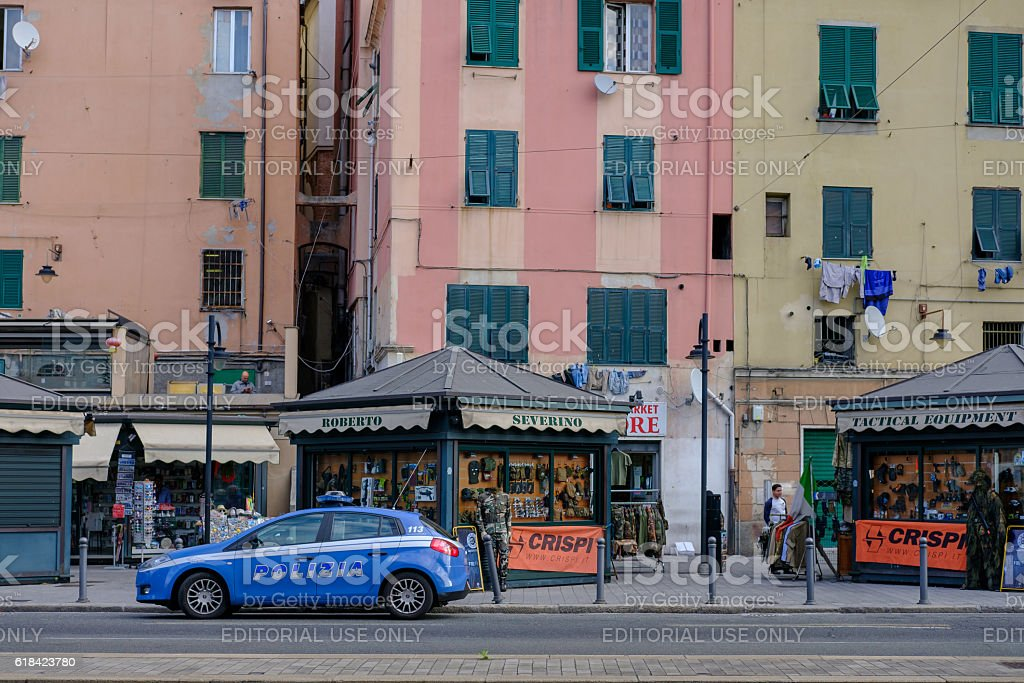 Buildings, mini-stores and police car in Genoa, Italy stock photo