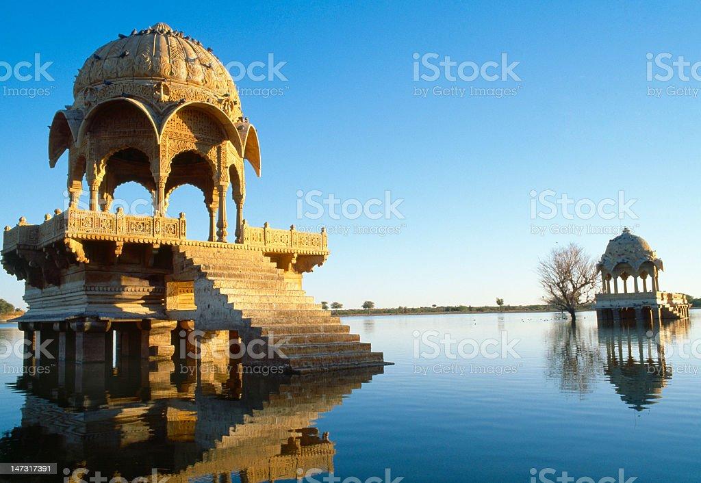 Buildings on Gadi Sagar lake in Jaisalmer, Rajasthan, India stock photo
