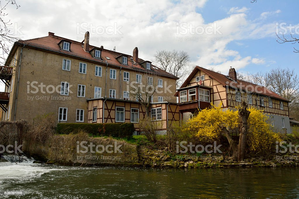 Buildings on the bank of Ilm River in Weimar, Germany. stock photo