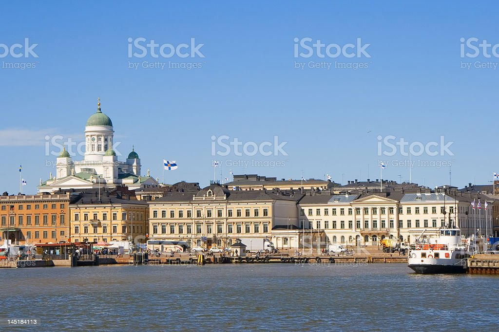 Buildings overlooking a harbor with a church in the back royalty-free stock photo