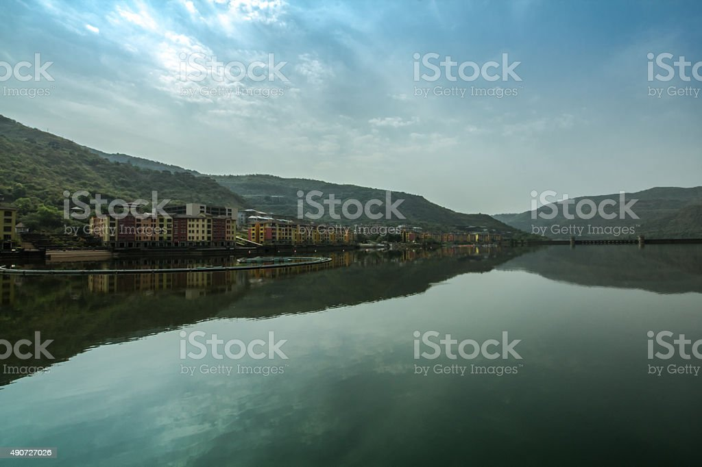 Buildings reflected on lake, scene from western India stock photo