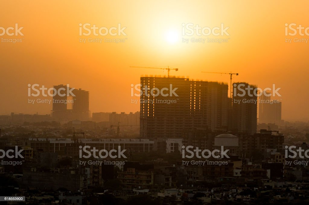 Buildings under construction at dusk stock photo