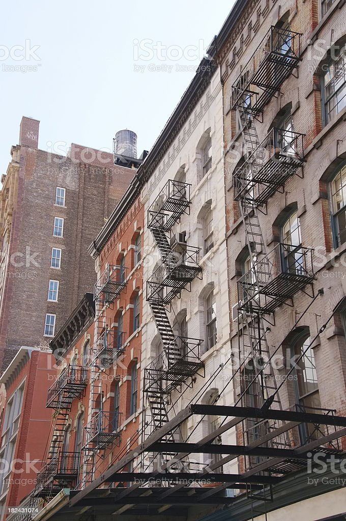 Buildings with fire escapes in NYC royalty-free stock photo