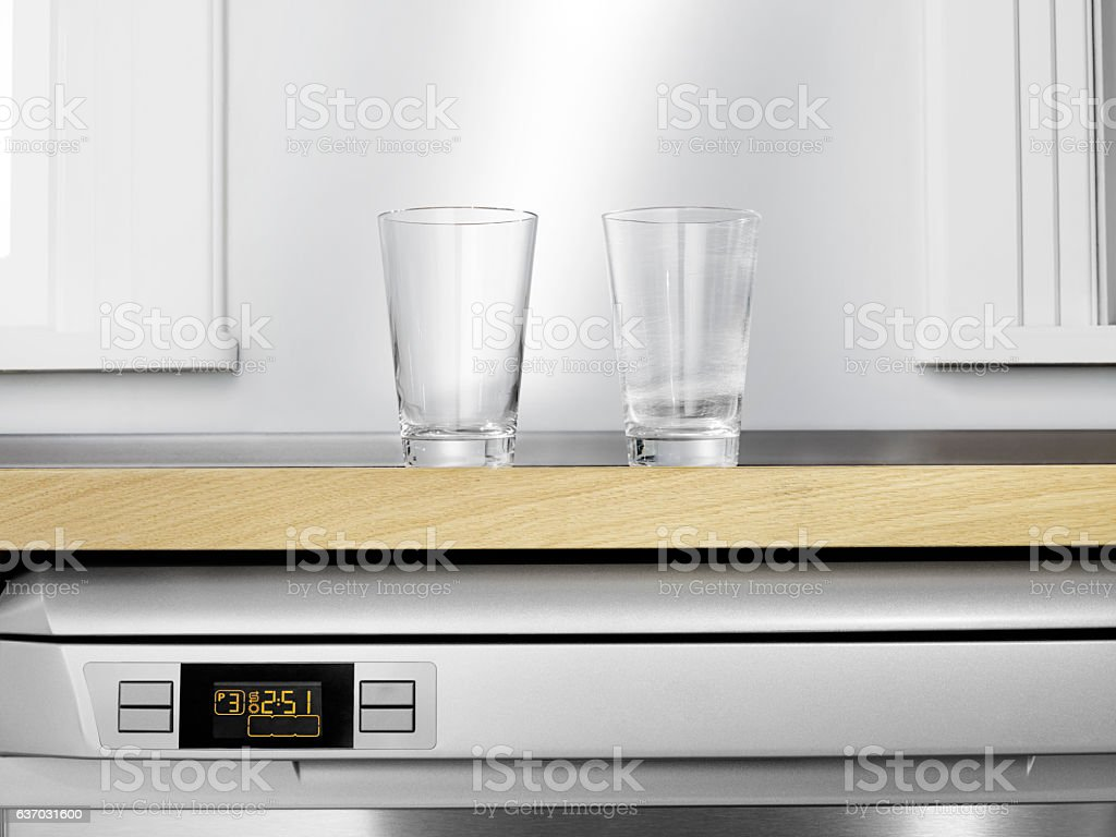 Built in Dishwasher, scratch glass cup stock photo