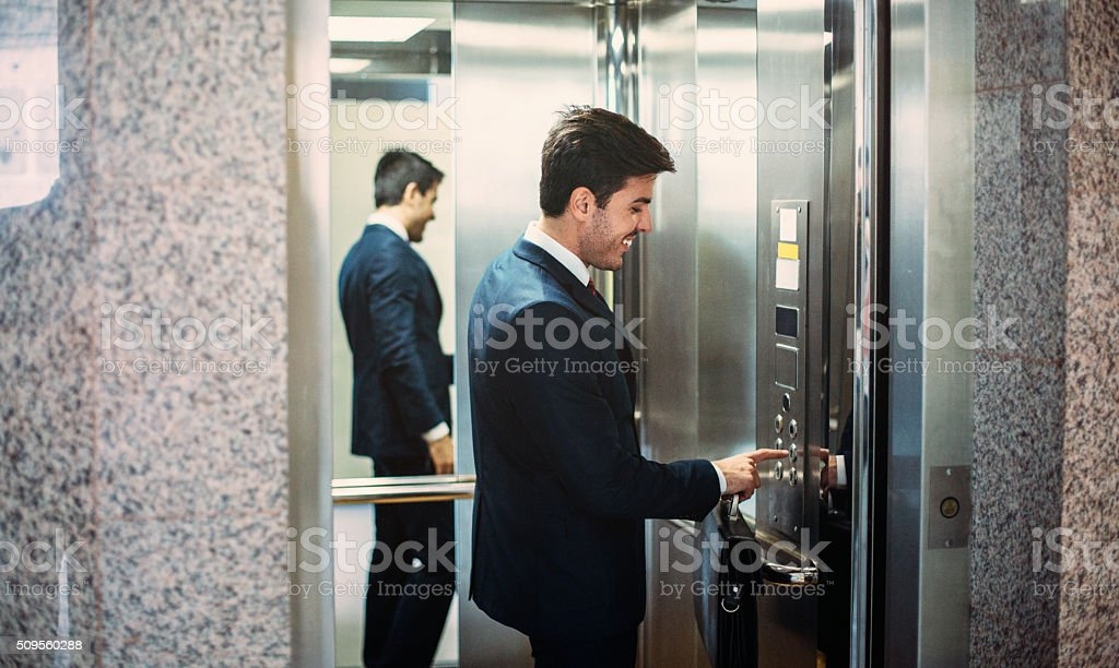 Buisnessman In The Elevator stock photo