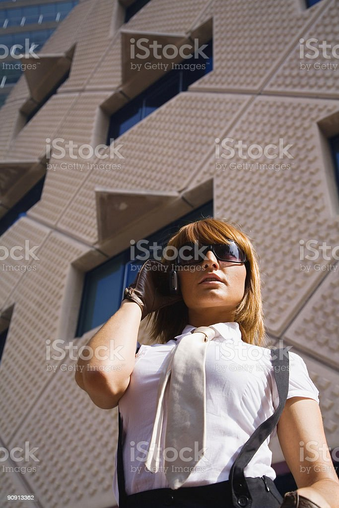 Buisnesswoman speaking by a cellphone royalty-free stock photo