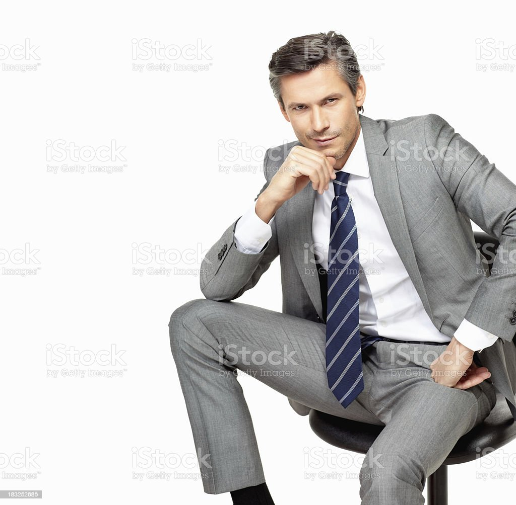 Buissnessman sitting in a chair against white background royalty-free stock photo