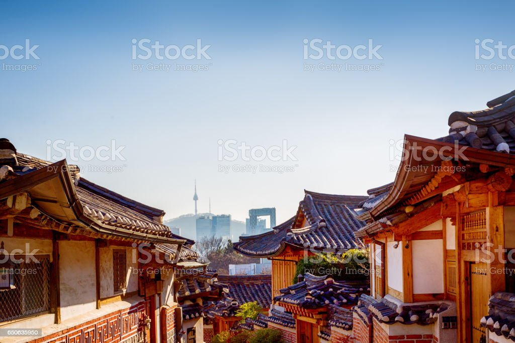 Bukchon Hanok Village with Seoul Downtown Background stock photo