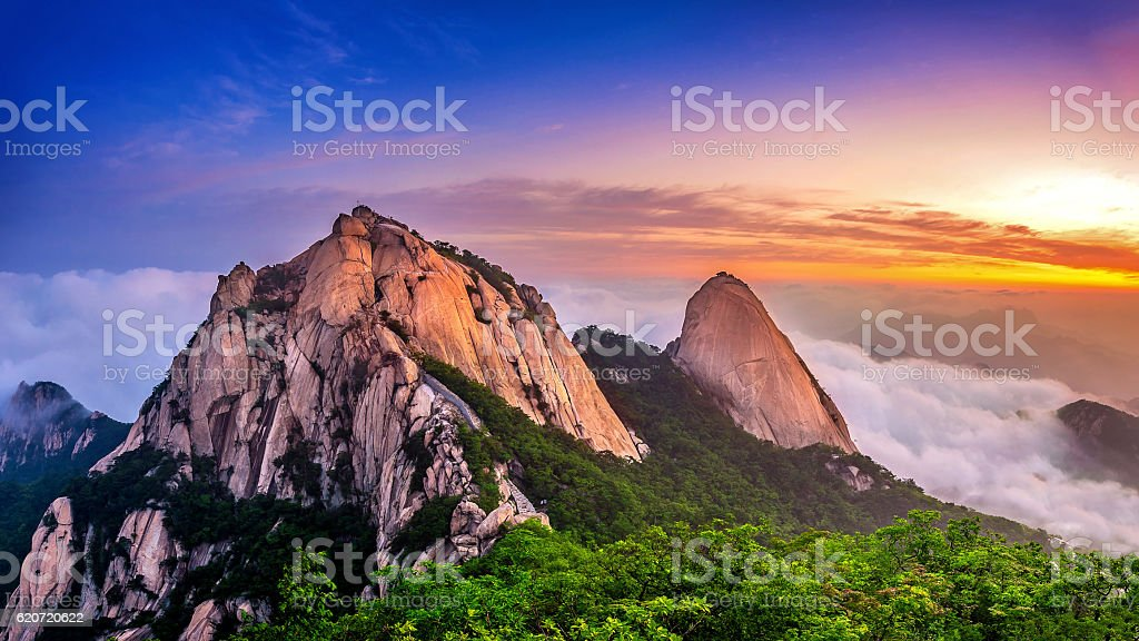 Bukhansan mountains is covered by morning fog and sunrise. stock photo