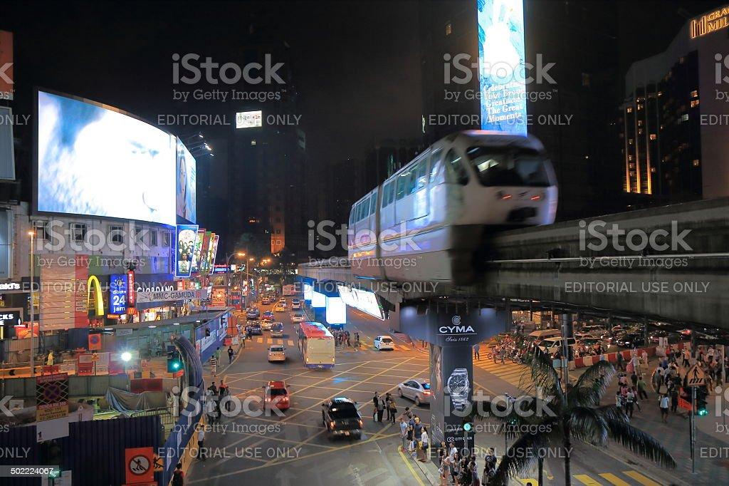 Bukit Bintang and monorail night Kuala Lumpur Malaysia stock photo