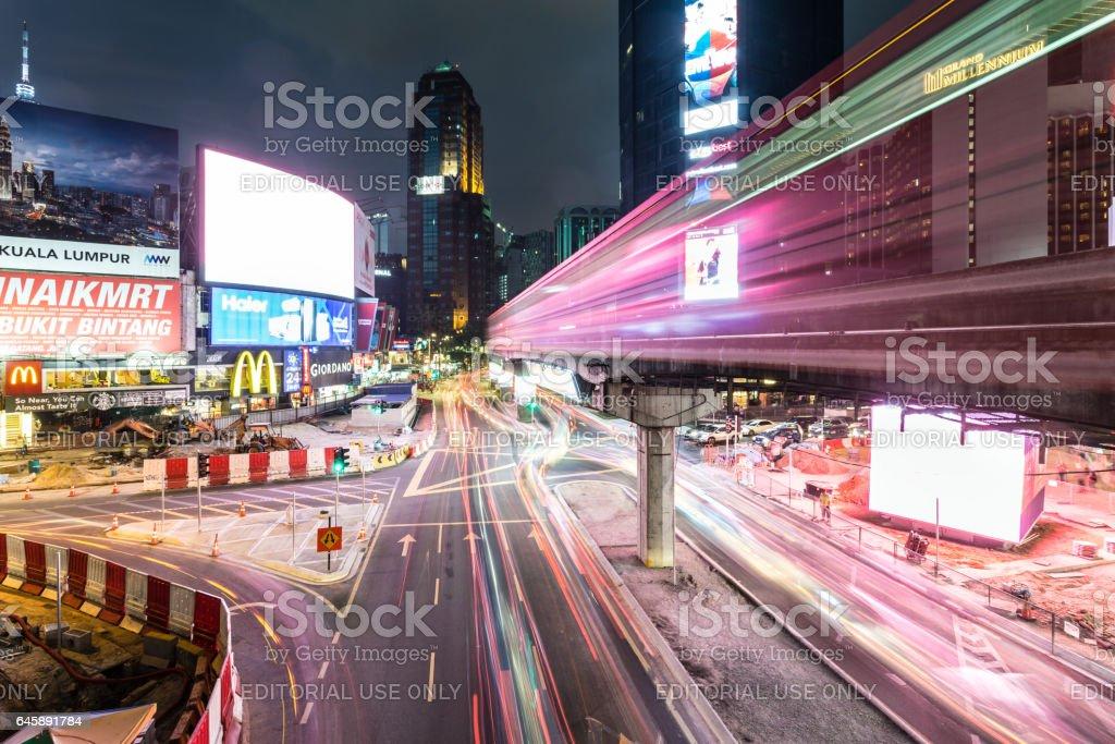 Bukit Bintang intersection at night in Kuala Lumpur, Malaysia capital city. stock photo