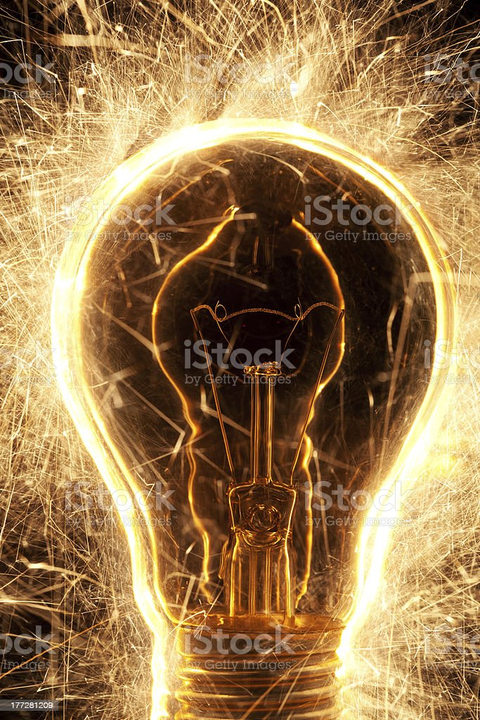 bulb and sparklers   on black background stock photo