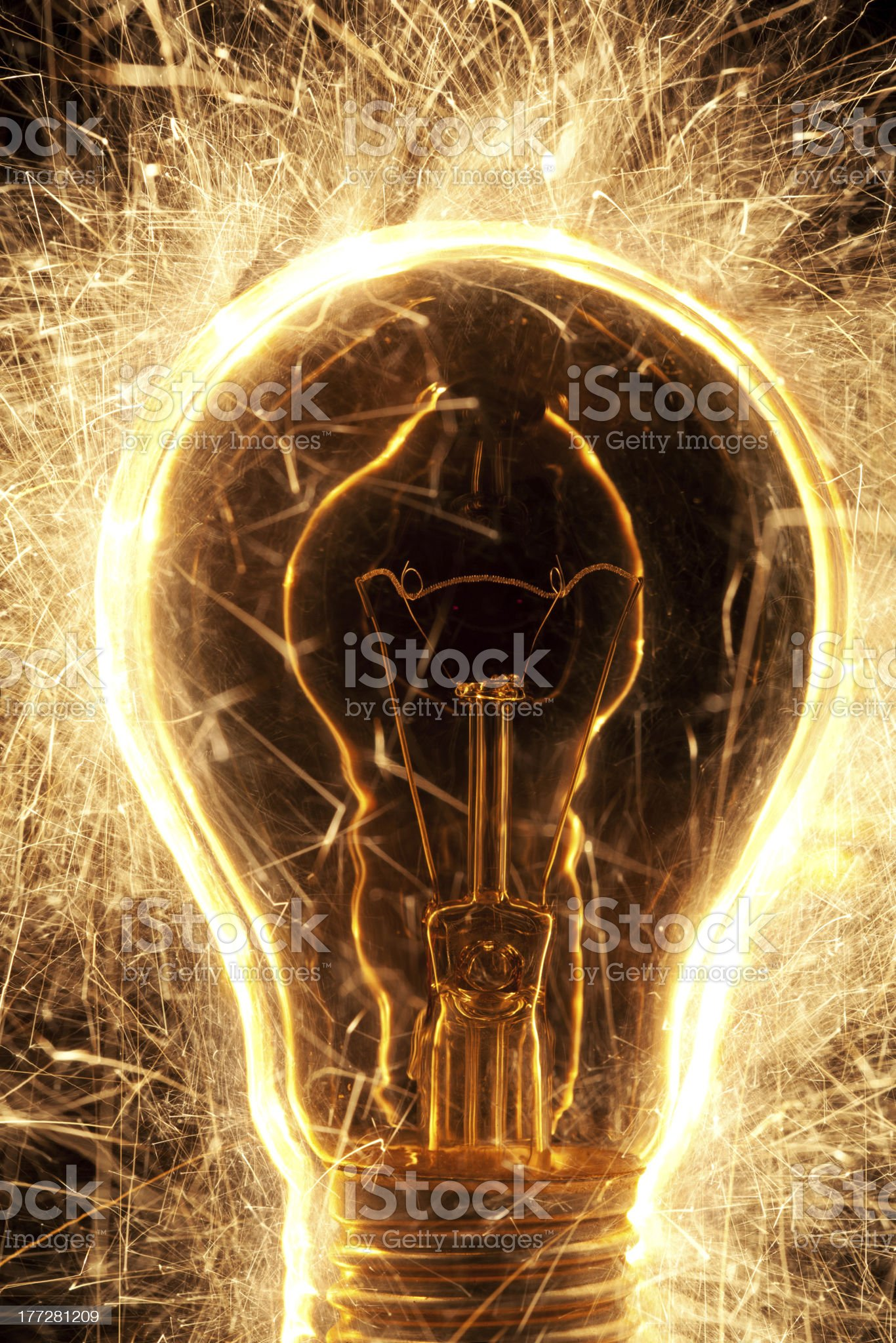 bulb and sparklers   on black background royalty-free stock photo