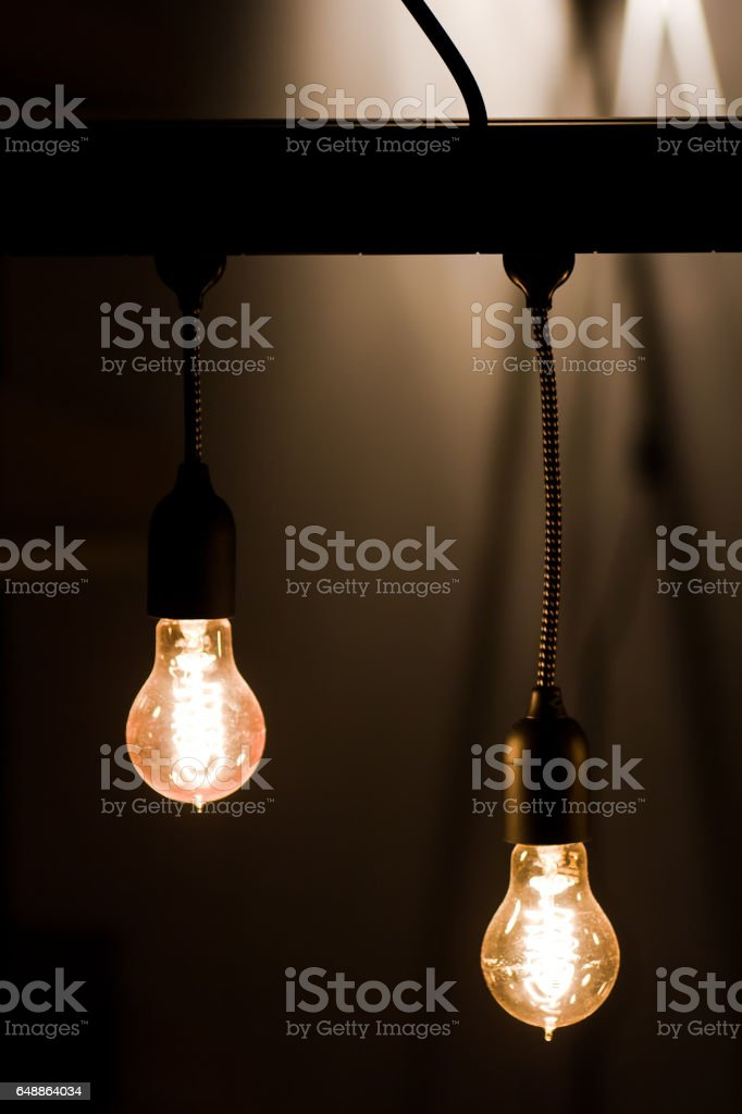 Bulb hanging by a thread stock photo