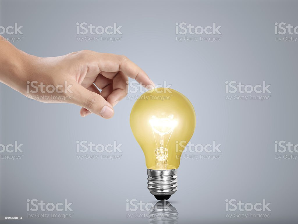 bulb light in a hand royalty-free stock photo