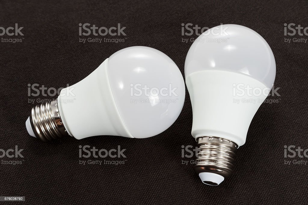 LED bulb on black cloth stock photo