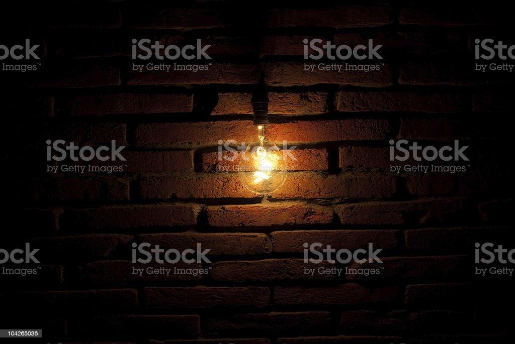 bulb on wall stock photo