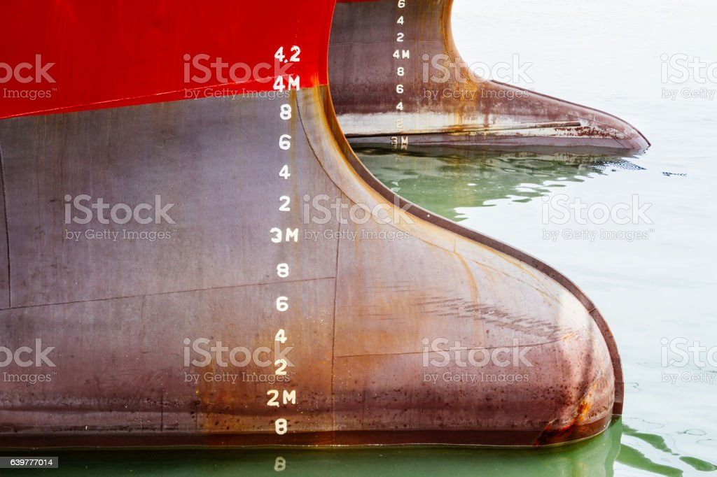 Bulbous bow of two ships with draft measurement stock photo