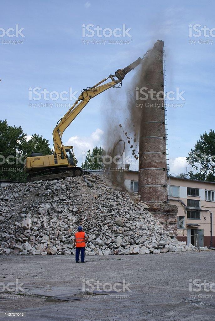 BuldoAer niszczAcy komin / Bulldozer destructive chimney stock photo