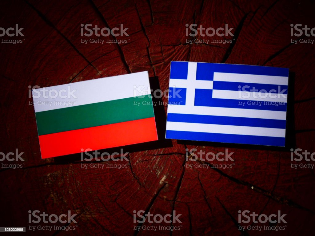 Bulgarian flag with Greek flag on a tree stump isolated stock photo