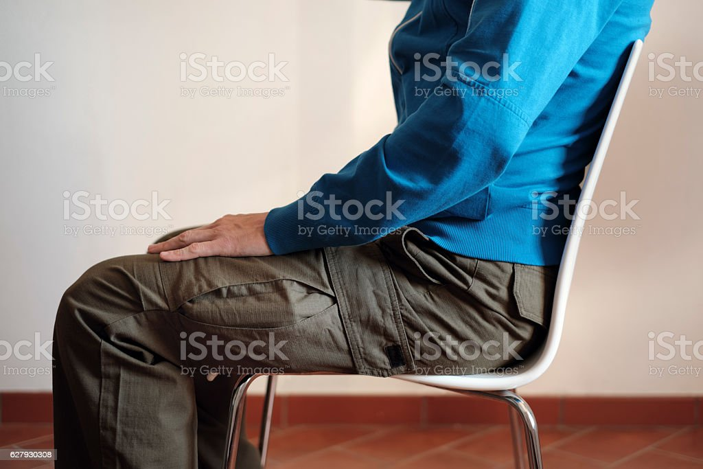 Bulging pockets are comfortable if worn alongside trousers' legs stock photo