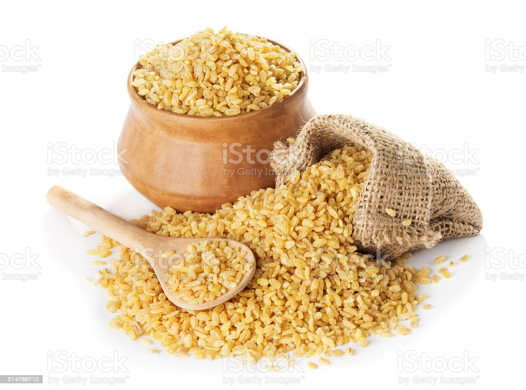 Bulgur  in a bag and clay bowl stock photo