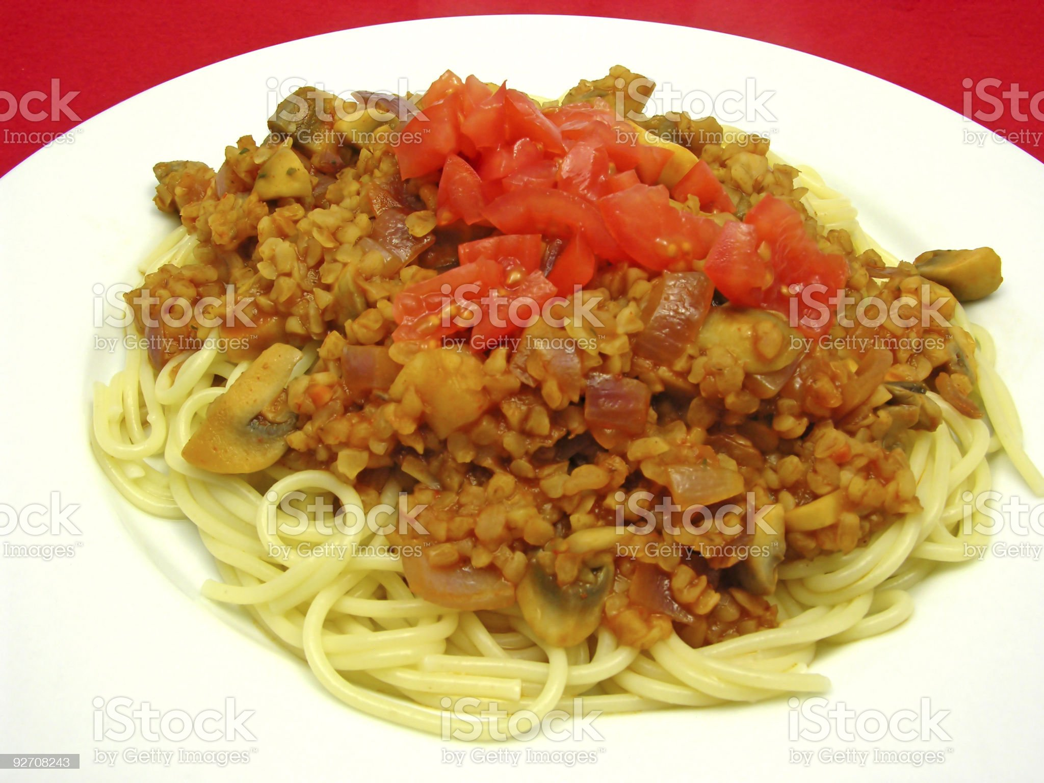 Bulgur wheat groats with noodles and tomatoes royalty-free stock photo