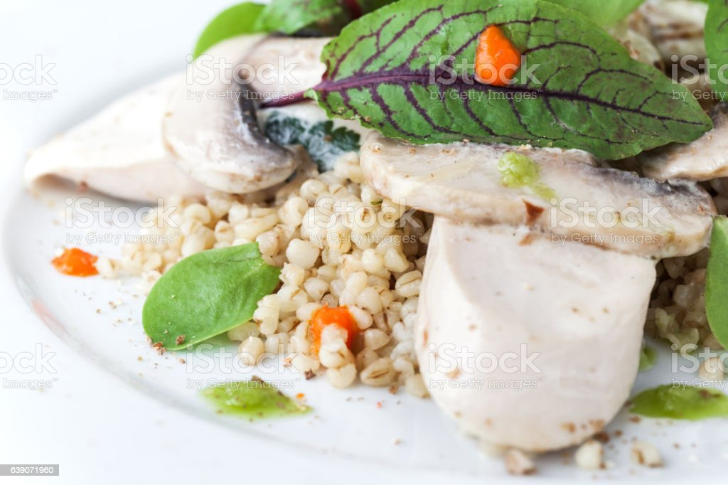 Bulgur with basil and chicken studio isolated stock photo