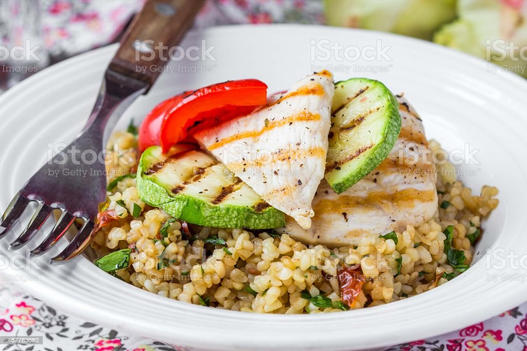 Bulgur with vegetables and grilled chicken, healthy, diet summer stock photo