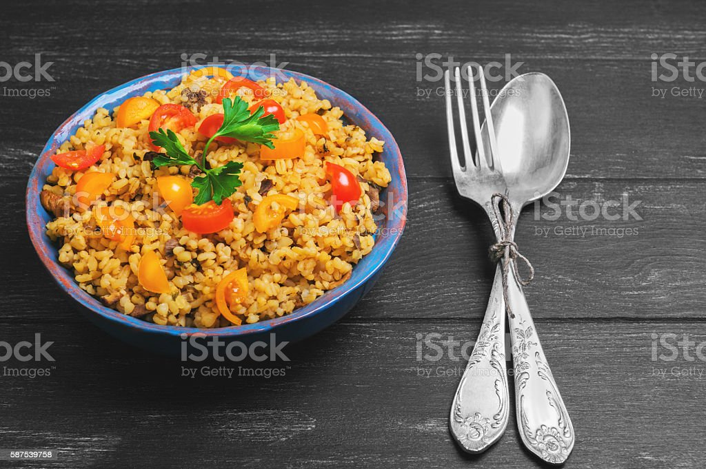 Bulgur with yellow and red cherry tomatoes stock photo