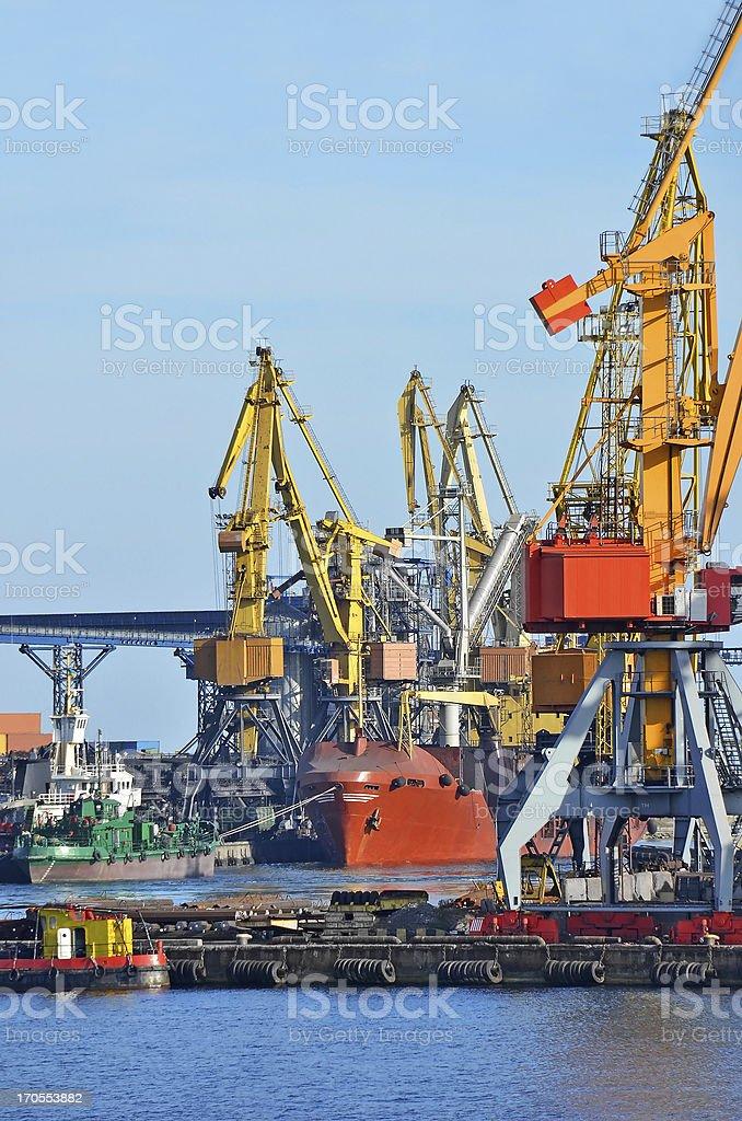 Bulk cargo ship under port crane royalty-free stock photo
