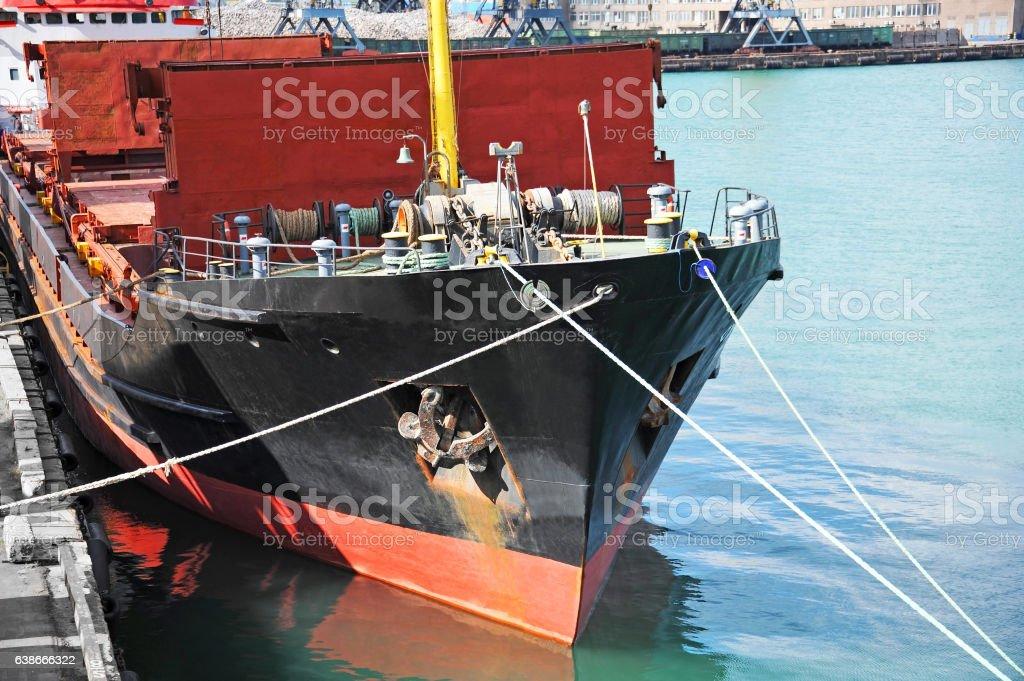 Bulk cargo ship under port crane stock photo