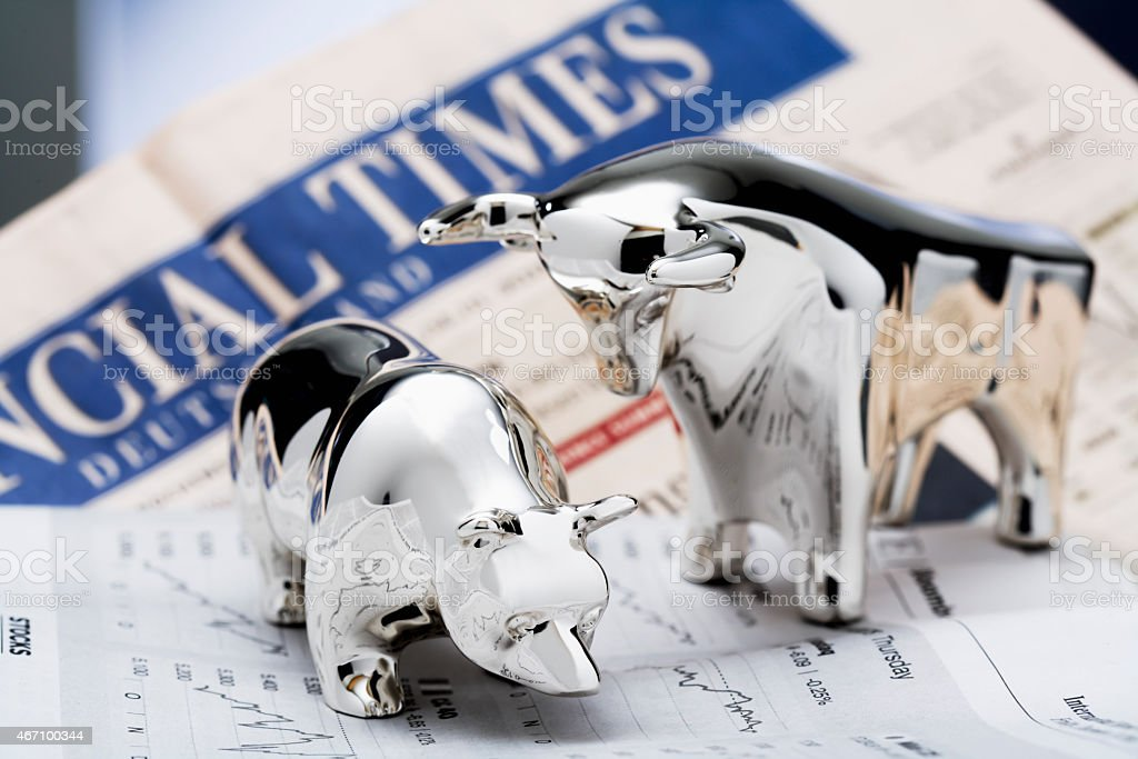bull and bear, Financial Times in the background stock photo