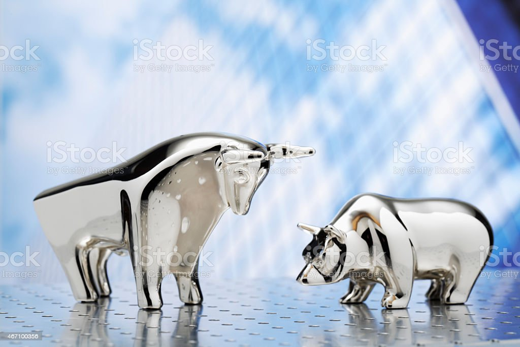 Bull and bear, high-rise building in the background stock photo