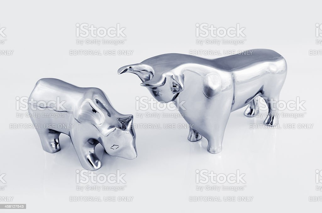 Bull and bear on a white background stock photo