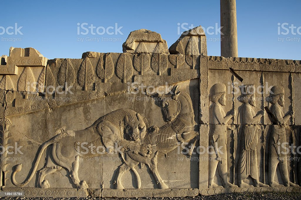 Bull and lion fight on the walls of Persepolis, Iran stock photo