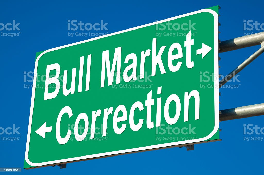 Bull Market or Correction Highway Sign stock photo