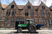 Bulldozer and traditional Bruges brick houses, Belgium