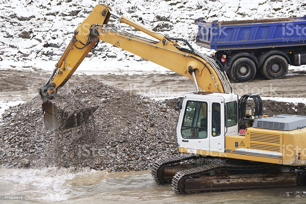 Bulldozer deepening the riverbed royalty-free stock photo