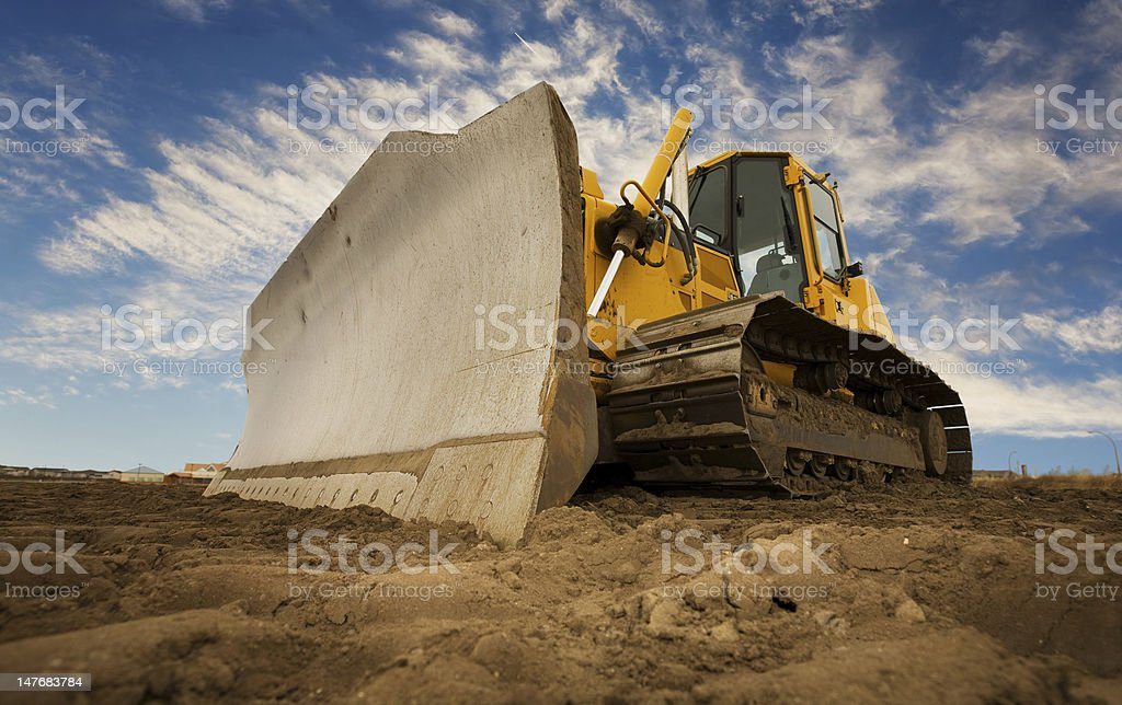 A bulldozer digging up the earth stock photo