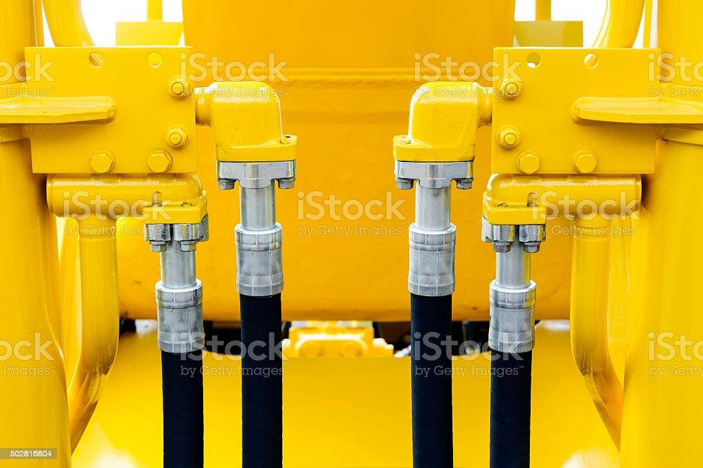 Bulldozer hydraulic hoses stock photo