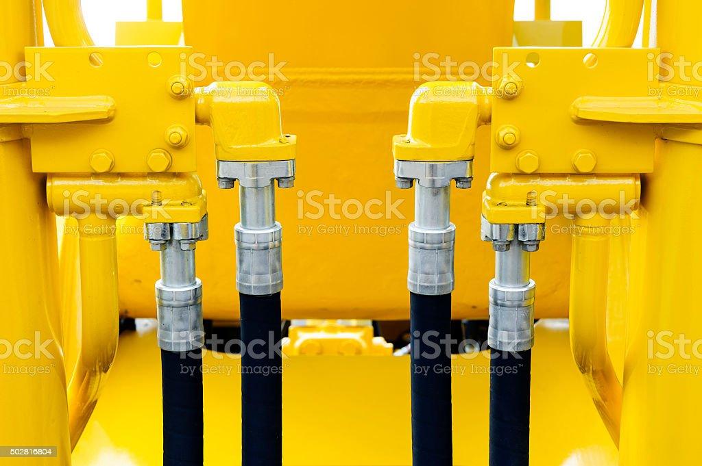Bulldozer hydraulic hoses stock photo