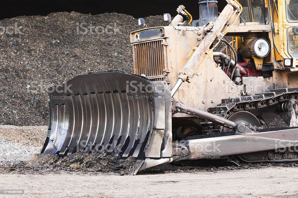 Bulldozer in construction site stock photo