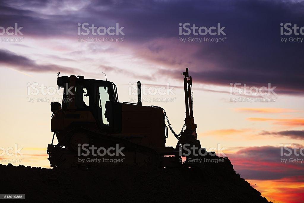 Bulldozer in the building site stock photo