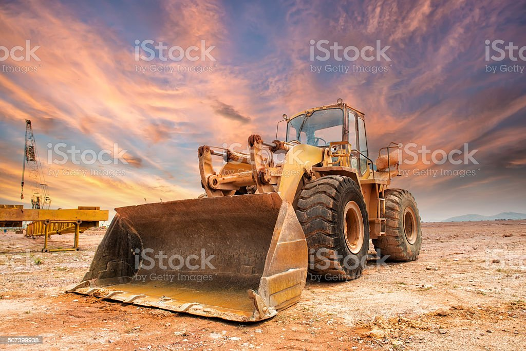 Bulldozer loader machine during earthmoving works stock photo