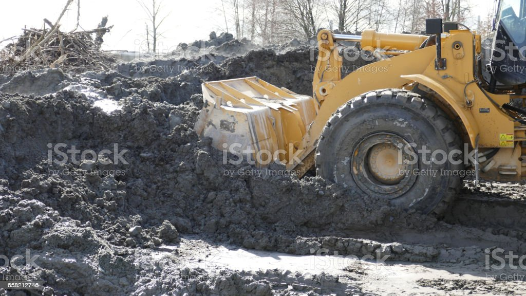 Bulldozer moving earth stock photo