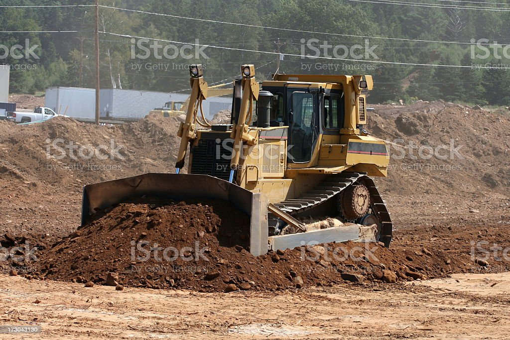 Bulldozer moving soil in construction area royalty-free stock photo