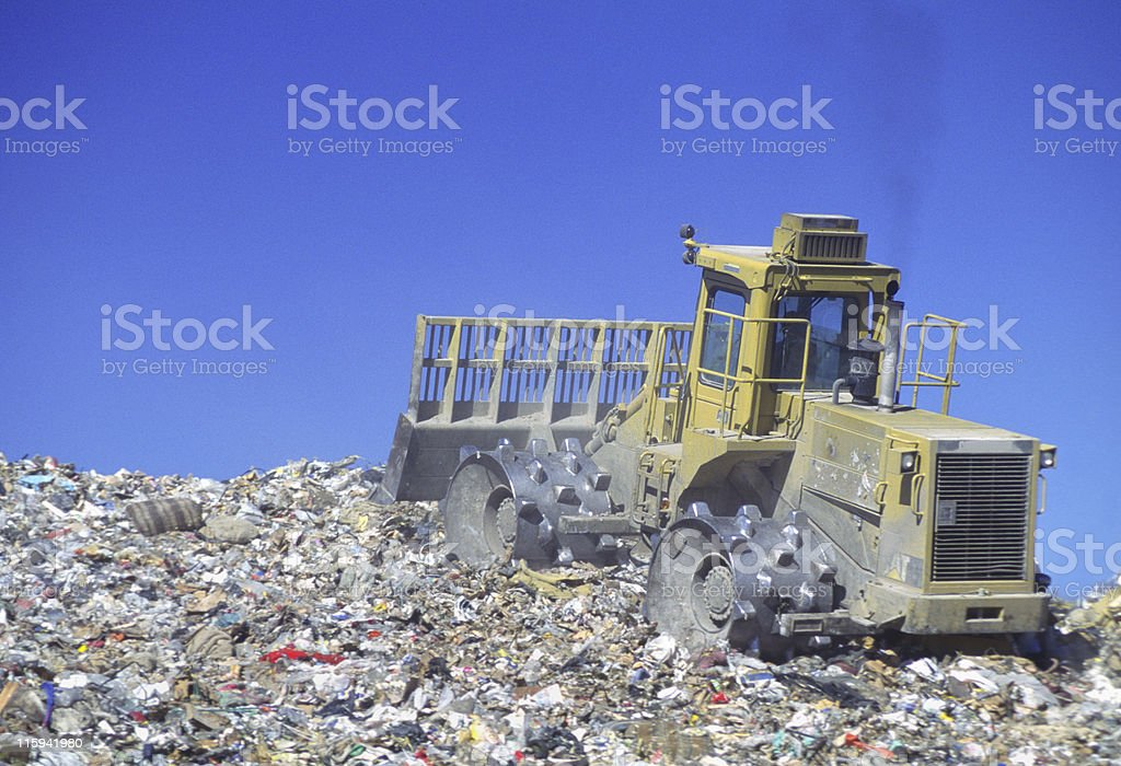 Bulldozer on Landfill royalty-free stock photo