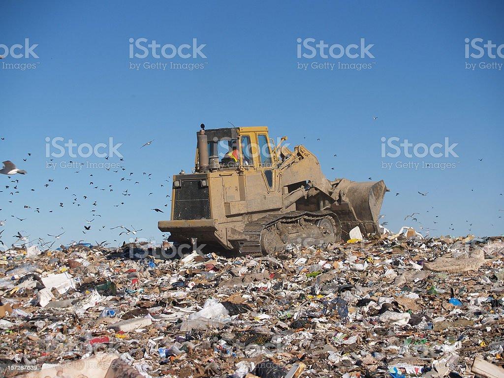 Bulldozer on Sea of Garbage royalty-free stock photo