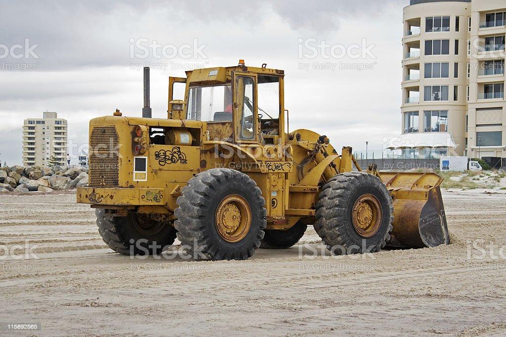Bulldozer on the beach royalty-free stock photo